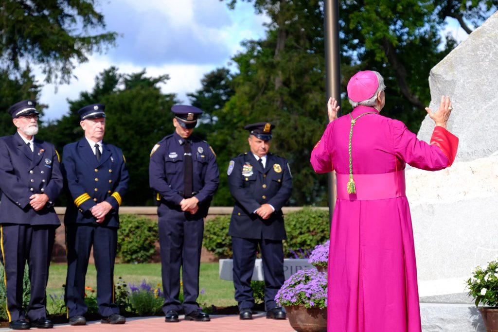 Bishop Matano performing a blessing