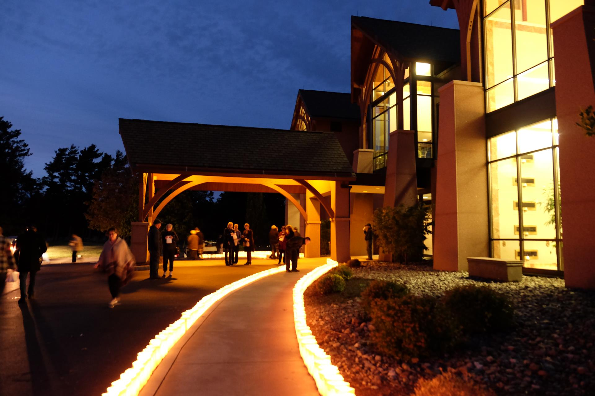 Photo of Lanterns lining a walkway at night