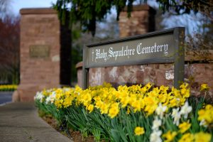 Photo of Daffodils in front of Holy Sepulchre sign