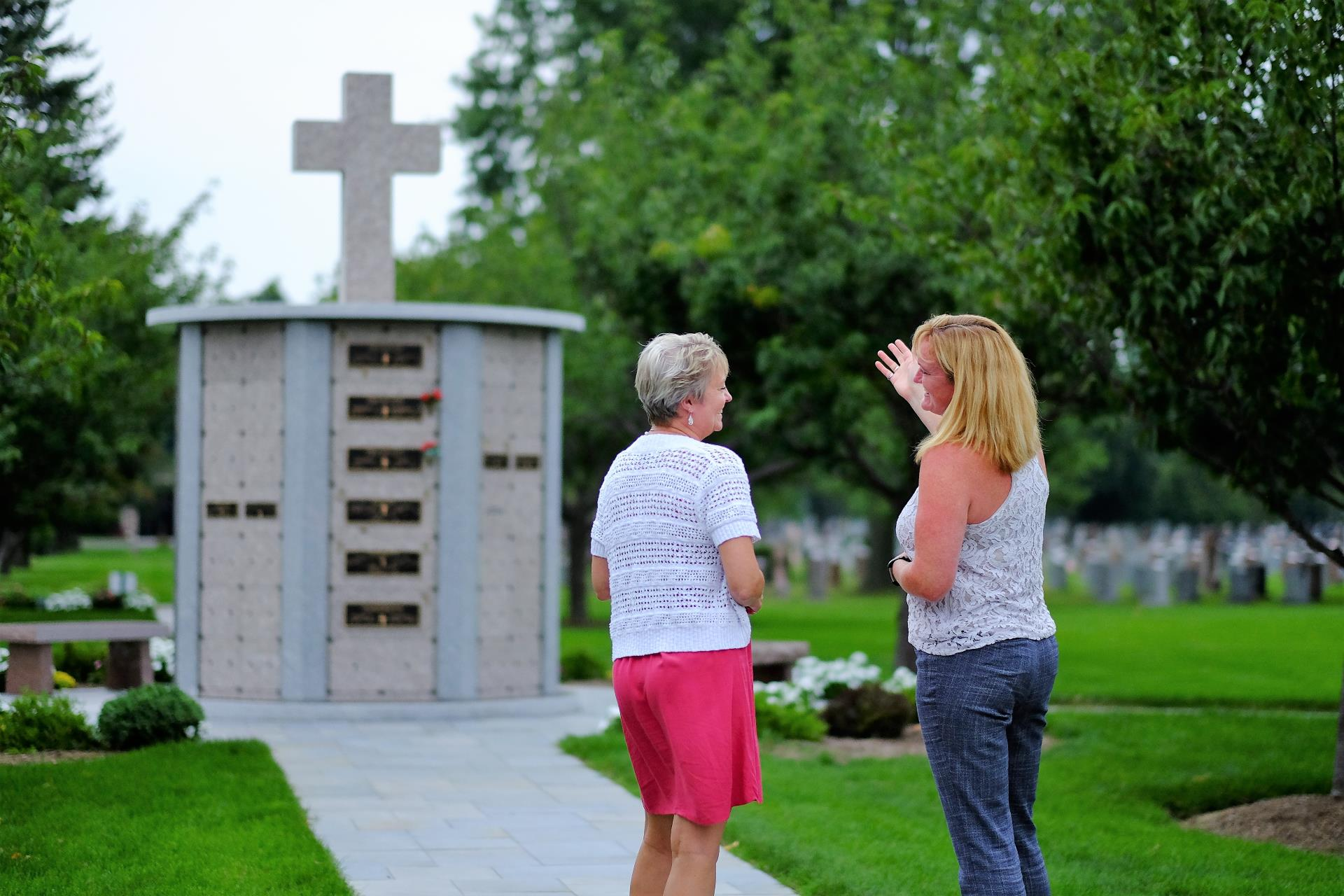 2 women near a columbarium